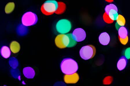 Light bokeh background, fairy lights, city holiday concept Archivio Fotografico - 134704675
