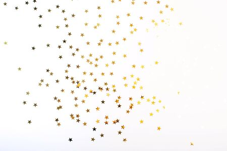 Golden stars on white background. Flat lay, top view.