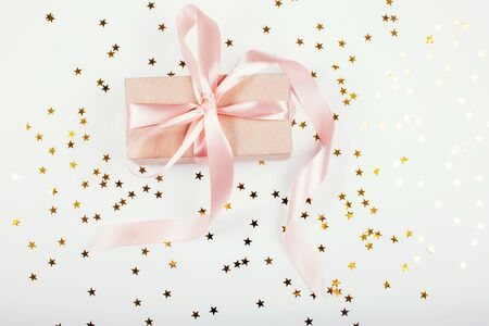 Gift or present box and stars. Flat lay composition. New Year 2020 concept Stock Photo