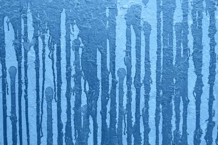 Blue classic color graffiti background on wall in city