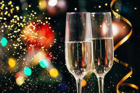Champagne in the the glass against the background of the christmas tree, New Year Christmas. New year concept 2020