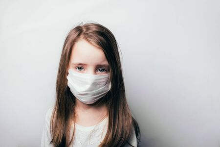 Child in a medical mask, protection against flu and colds