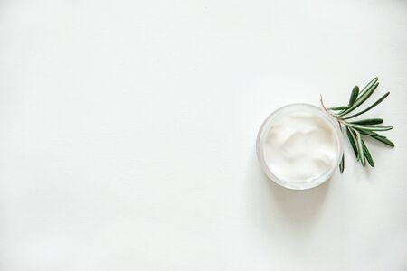 Herbal dermatology, hygienic cream skincare product in glass jar on white background