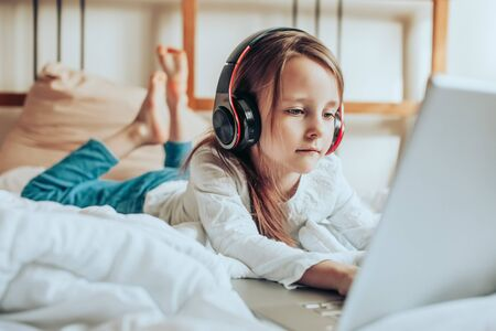 Online kid remote learning. Child studying from home. Homeschooling during quarantine and coronavirus outbreak.