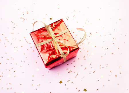 Glitters and present on a pink background, christmas and new year fun concept