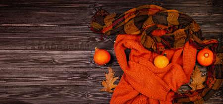 Orange autumn clothes. Autumn Arrives. Lady Clothes Outfit. Fall fashionable mood. Halloween autumnal flatlay. Orange color. Zdjęcie Seryjne