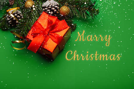 Christmas background with New Year decorations and snow on green background