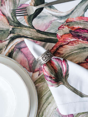 Table setting. Napkins with red flowers