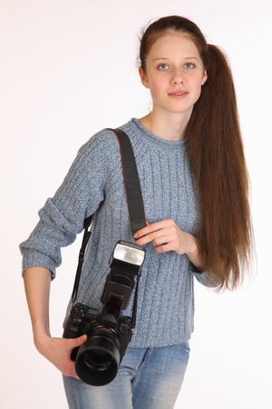 Woman photographer with big professional photo camera  photo