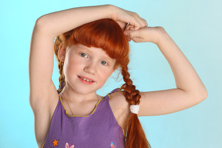 Close-up portrait of beautiful charming little redhead girl. Happy attractive child posing in a summer clothes. The pre-teen fashion model 8 years old. Standard-Bild