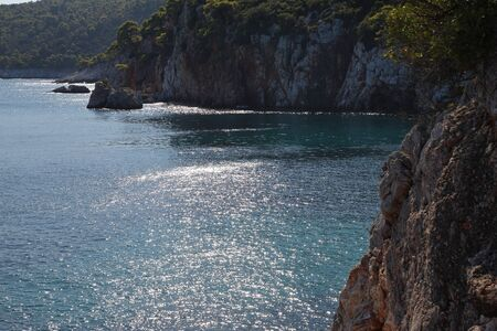 Azure coves and beautiful bays of the Mediterranean Sea off the coast of Greece, the island Skopelos. Reklamní fotografie