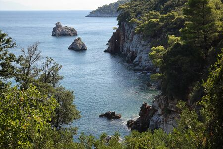 Azure coves and beautiful bays of the Mediterranean Sea off the coast of Greece, the island Skopelos. Фото со стока