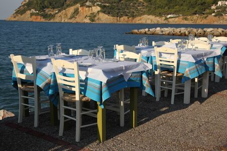 Restaurant in the open air by the sea, evening. Mediterranean Sea, South of Europe, Greece, Skopelos Island. Reklamní fotografie