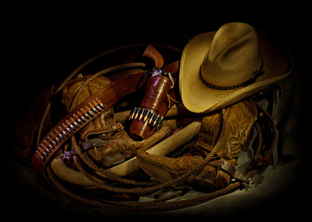 six shooter: Boots and Gear - Cowboy gear with horse collar, lariat, six shooter, cowboy hat, boots, and spurs