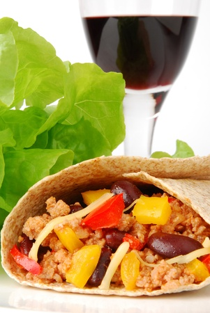 taco tortilla: Burrito with meat, beans and a glass of wine