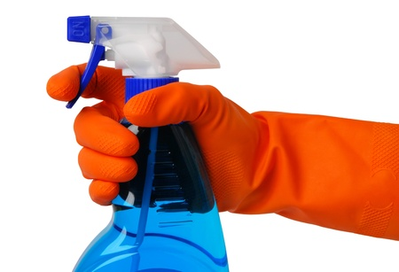 disinfect: Gloved hand with an atomizer