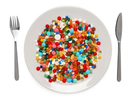Pilules servi un repas sain Banque d'images