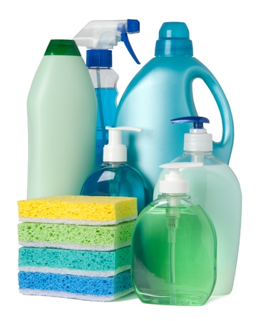 Blue and green containers of cleaning supplies Stock Photo