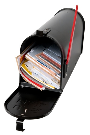 mail us: Mailbox full of mail  Stock Photo