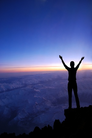 Woman on a top of a mountain at dawn  photo