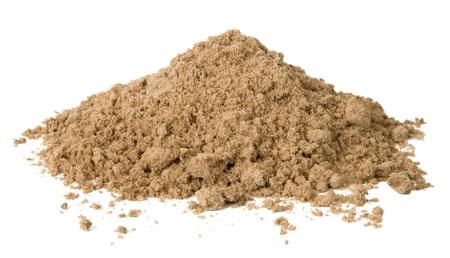 sandy soil: Mucchio di sabbia isolato su bianco