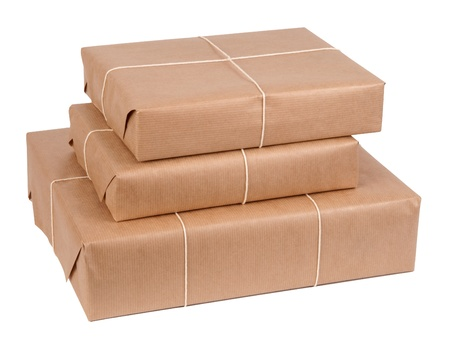 send parcel: Brown paper packages tied up with string