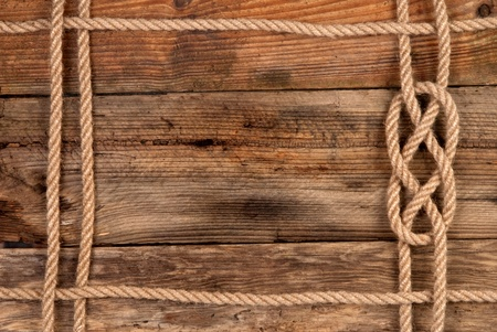 rope border: Rope frame on wooden background  Stock Photo