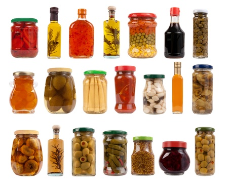 Jars and bottles with pickles, sauces and olive oil  photo