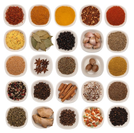 Spices and herbs isolated on white  photo