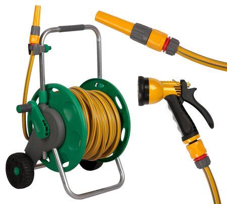 Gardening hose with nozzles isolated on white
