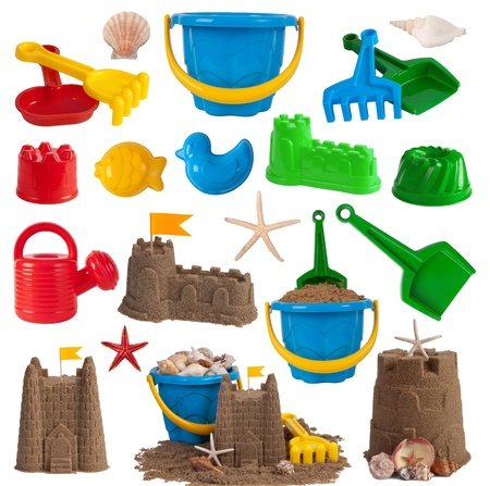 Beach toys and sand castles isolated on white