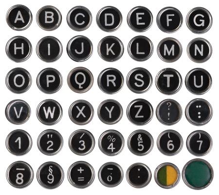 古いタイプライターのキー、アルファベット、数字、白い背景で隔離