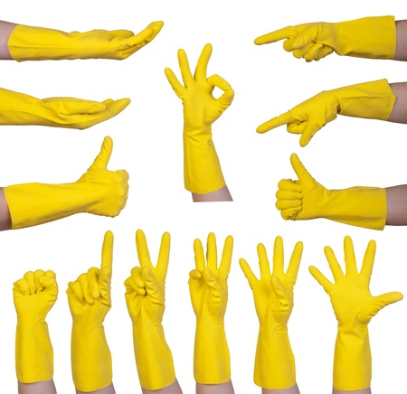 Hand gestures in yellow rubber glove isolated on white background  Stock Photo - 21151671