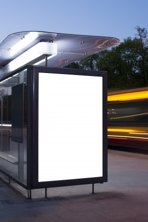 public space: Blank billboard on bus stop at night  Stock Photo