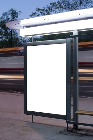 Blank billboard on bus stop at night  Stock Photo