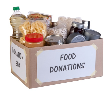 charitable: Food donations box isolated on white background  Stock Photo