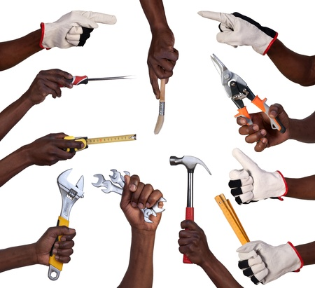 Hands holding tools isolated on white background  Stock Photo