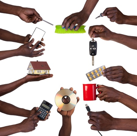 african american male: Hand holding various objects isolated on white  Stock Photo