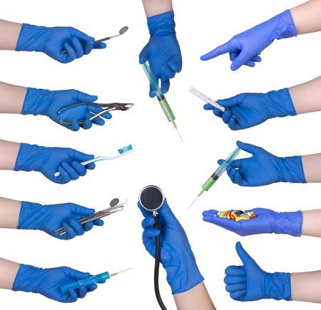 surgical needle: Hand in protective glove holding medical objects  Stock Photo