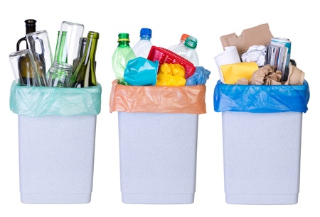 Recycling rubbish  Tree bins full of plastic, paper and glass isolated on white background