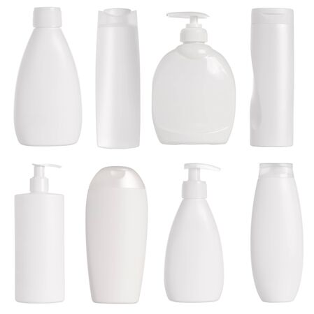 White containers and bottles isolated on white background  photo
