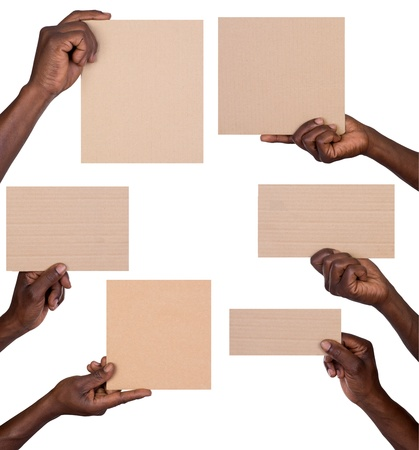 dark skinned: Man holding pieces of cardboard  Stock Photo