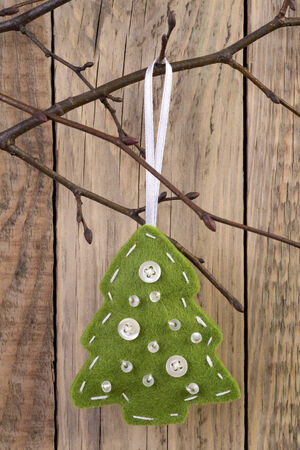 Christmas tree decoration hanging on a twig  photo