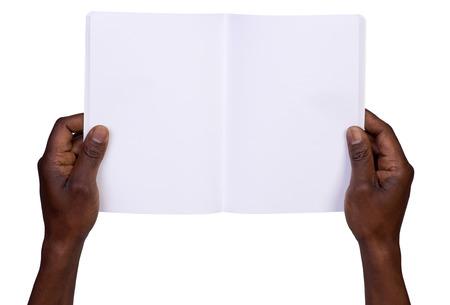 american media: Man holding blank notebook