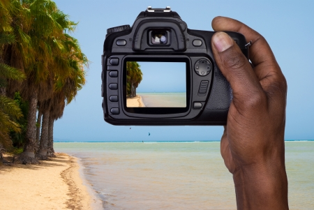 Man taking a picture of a beach  photo