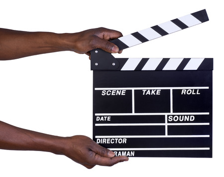Man holding movie production clapper board isolated on white background  photo