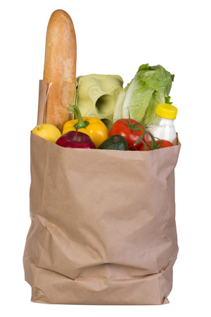 Groceries in paper bag isolated on white background  photo