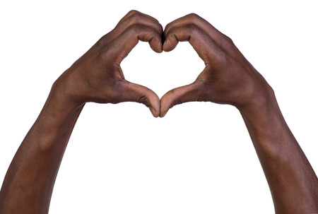 love symbol: Hands in the form of heart isolated on white background Stock Photo