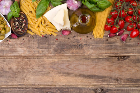 Italian food ingredients on wooden background with copy space photo