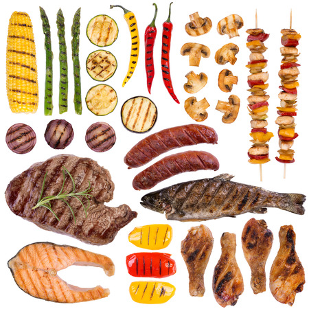 Grilled meat, fish and vegetables isolated on white background